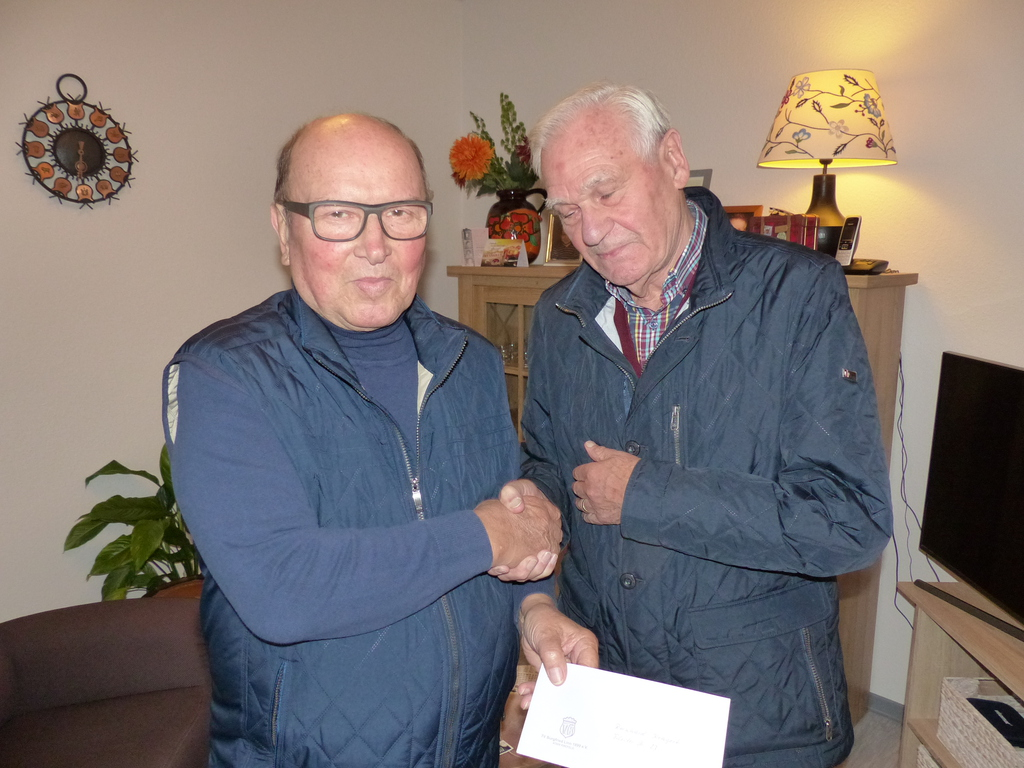 Theo Tilosen gratuliert Reinhard Kragert zum 80. Geburtstag